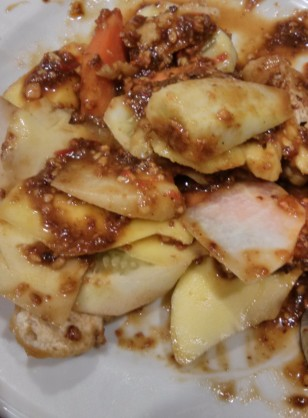 Rujak Buah (fruit salad with peanut, chili pepper, and palm sugar dressing)
