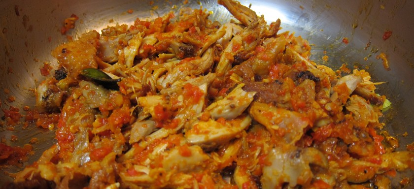 Shredded chicken mixed in chili peppers
