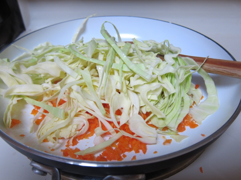 Cooking the cabbage and carrots