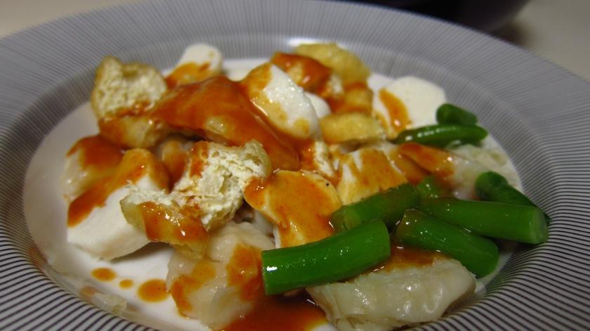 seafood dumplings, tofu, green beans in peanut sauce